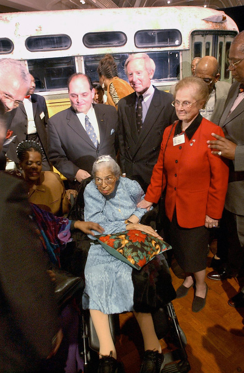. This file photo dated 01 December 2001 shows US civil rights icon Rosa Parks (C) attending the commemoration of the 46th anniversary of her arrest aboard a Montgomery, Alabama, bus in 1955 at the Henry Ford Museum in Dearborn, Michigan. It was reported 24 October, 2005 that Rosa Parks, who helped spark the civil rights movement when she refused to give up her bus seat to a white man in 1955, has died at the age of 92.  The bus, pictured behind, had recently been acquired by the Henry Ford Museumr.   (JEFF KOWALSKY/AFP/Getty Images)