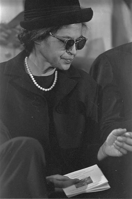 . Rosa Parks, who refused to move to the back of the bus and touched off the civil rights movement in Montgomery, Alabama in 1955, stands during services in Atlanta commemorating the birthday of Dr. Martin Luther King, Jr., January 15, 1969.  Dr. King was pastor of a Montgomery church at the time.  (AP Photo/stf)