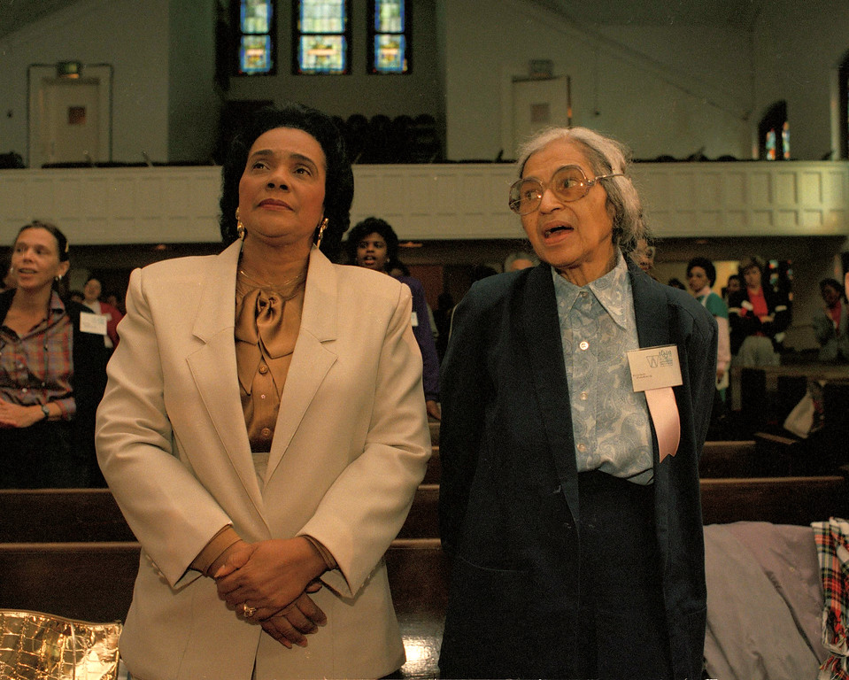 ". Rosa Parks , right, and Coretta Scott King, wife of slain civil rights leader Dr. Martin Luther King, Jr., sing ""Come By Here My Lord\"" at Ebenezer Baptist Church in downtown Atlanta, Oct. 12, 1988, at the opening of the \""Women in the Civil Rights Movement: Trailblazers and Torchbearers\"" conference.  (AP Photo/Judy Ondrey)"