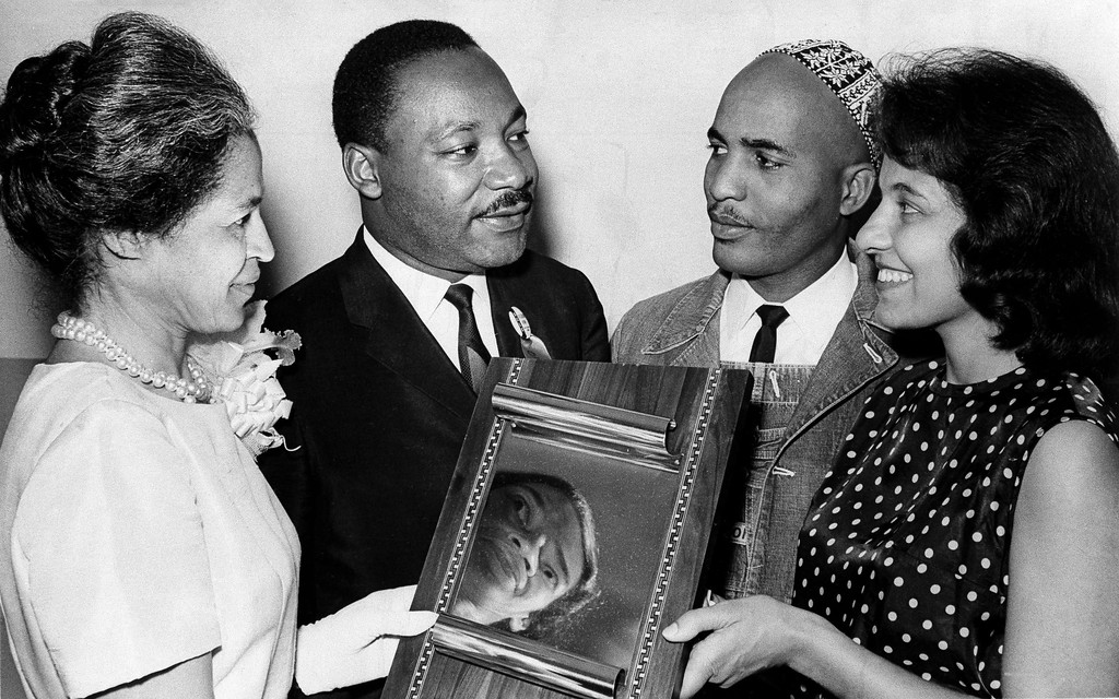 . Civil Rights worker Rosa Parks, left and Dr. Martin Luther King, second from left, present the Rosa Parks Outstanding Freedom Award to Reverend James Bevel and his wife Diane Bevel in a ceremony at the annual Southern Christian Leadership Conference in Birmingham, Ala., Aug. 13, 1965. (AP Photo)