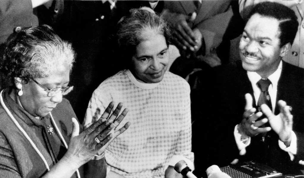 . Rosa Parks, center, whose refusal to give up her bus seat to a white man 20 years ago sparked the historic Montgomery bus boycott, is honored, Dec. 5, 1975 at ceremonies commemorating the civil rights crusade in Montgomery. Beside her are Mrs. Jonnie Carr, president of the Montgomery Improvement Association, and U.S. Rep. Walter Fauntroy of Washington, D.C. (AP Photo)