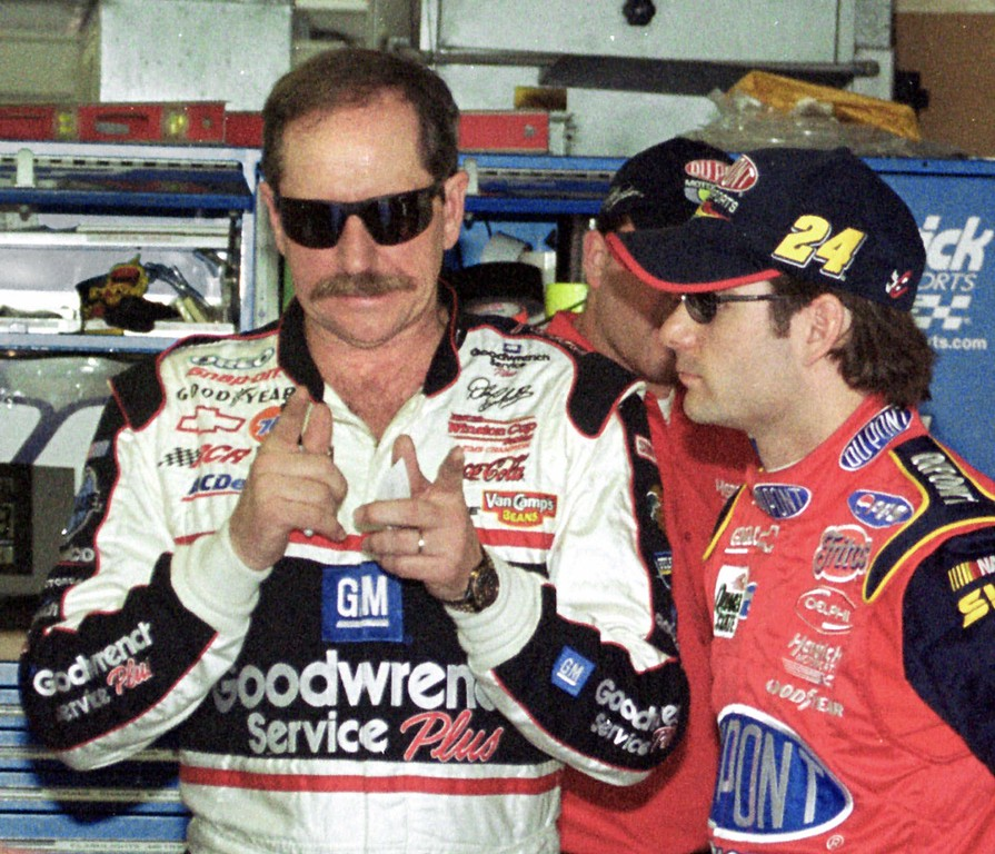 . In this 2001 file photo, NASCAR driver Dale Earnhardt, left, gestures as he talks to Jeff Gordon inside the garage at the Daytona International Speedway in Daytona Beach, Fla., before a practice run Friday morning Feb. 16, 2001. Dale Earnhardt Sr., considered one of the greatest drivers in National Association for Stock Car Auto Racing (NASCAR) history, died at the age of 49 in a last-lap crash at the 43rd Daytona 500 in Daytona Beach, Florida on February 18, 2001. (AP Photo/Bob Sweeten)