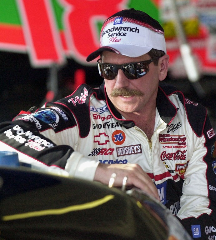 . File - Dale Earnhardt, of Kannapolis, N.C., leans on the hood of his backup Chevrolet while crew members change out an engine Friday afternoon, Feb. 9, 2001, at the Daytona International Speedway in Daytona Beach, Fla.  (AP Photo/Chris O\'Meara)