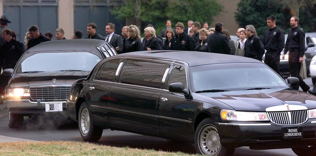 . Friends and family of NASCAR driver Dale Earnhardt Sr. enter Calvary Church in Charlotte, NC, 22 February 2001 for Earnhardt\'s  memorial service. Earnhardt was killed instantly in a last-lap crash of the 18 February 2001 Daytona 500 NASCAR race.  (ERIK PEREL/AFP/Getty Images)