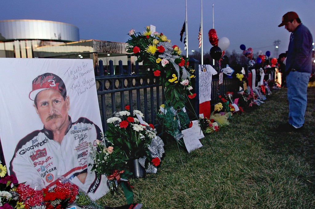 . A portrait of  NASCAR driver Dale Earnhardt, Sr., adorns a memorial outside Earnhardt\'s corporate headquarters 19 February 2001 in Moorseville, NC. The memorial was started by fans paying tribute to the NASCAR legend, who was killed 18 February 2001 during a final lap crash of the Daytona 500 NASCAR race.  (ERIK PEREL/AFP/Getty Images)