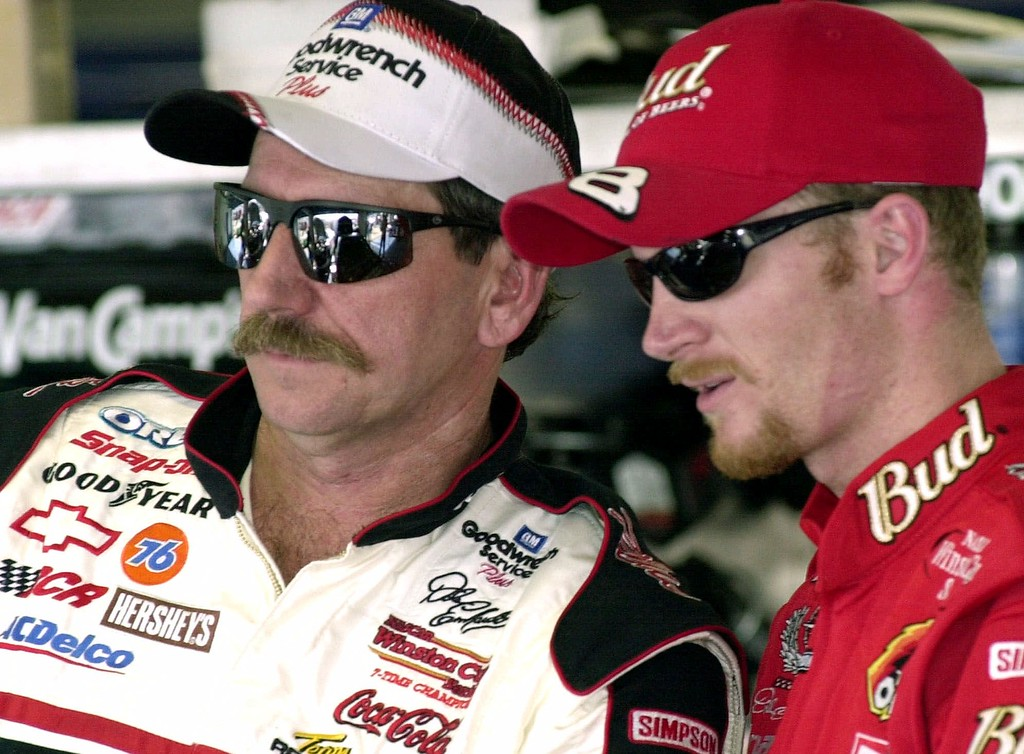 . File - NASCAR drivers Dale Earnhardt, left, and his son Dale Jr., stand together during a break in practice Friday afternoon, Feb. 9, 2001, at the Daytona International Speedway in Daytona Beach, Fla. (AP Photo/Paul Kizzle)