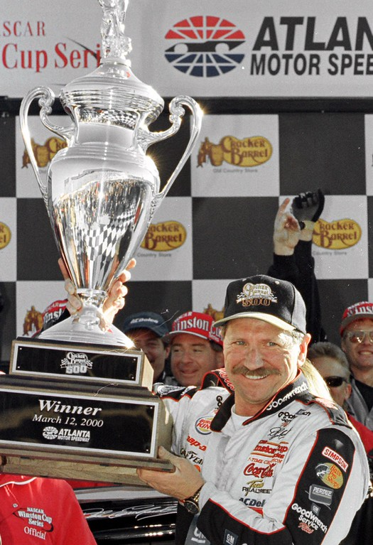 . File - Dale Earnhardt, of Kannapolis, N.C., holds the NASCAR Cracker Barrel 500 trophy after winning the race from a 35th-spot starting position Sunday, March, 12, 2000, at the Atlanta Motor Speedway in Hampton, Ga. (AP Photo/Ric Feld)
