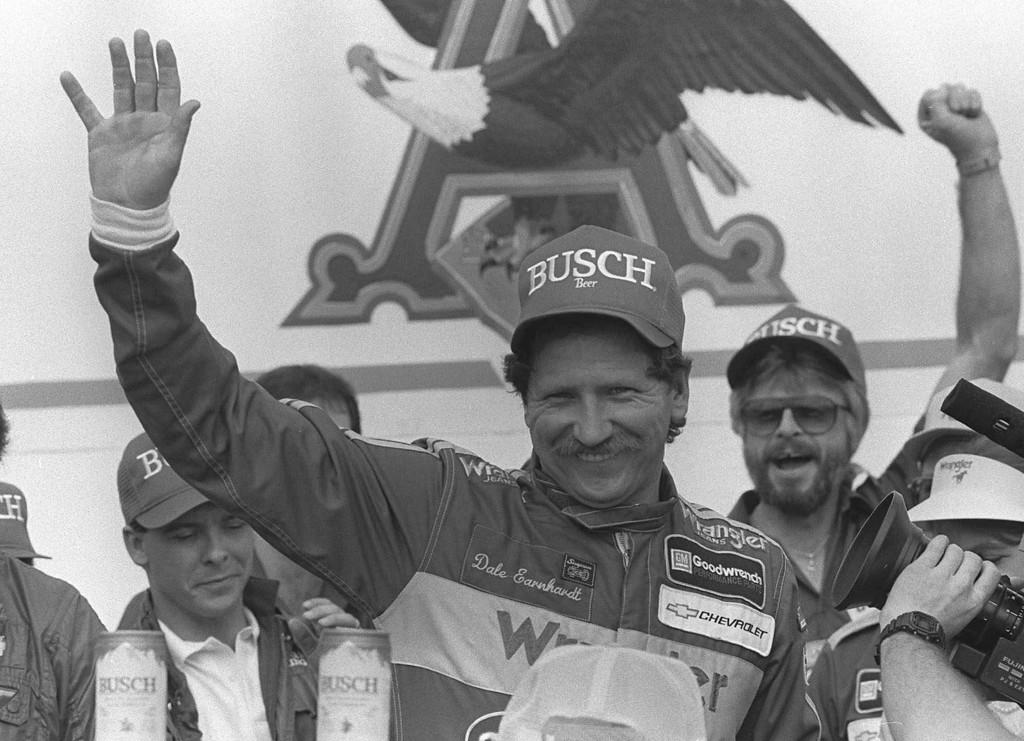. In this 1986 file photo, Dale Earnhardt Sr., from Kannapolis, N.C., waves in victory lane on Feb. 9, 1986 in Daytona Beach Fla. after winning the Busch Classic.  On Feb. 18, 2001, Dale Earnhardt Sr., considered one of the greatest drivers in National Association for Stock Car Auto Racing (NASCAR) history, dies at the age of 49 in a last-lap crash at the 43rd Daytona 500 in Daytona Beach, Florida. (AP Photo/Chuck Luzier)
