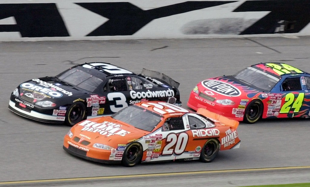 . File - Tony Stewart (20) passes Dale Earnhardt (3) and Jeff Gordon (24) during the later stages of the Budweiser Shootout Sunday afternoon, Feb. 11, 2001, at the Daytona International Speedway in Daytona Beach, Fla.  Dale Earnhardt Sr., considered one of the greatest drivers in National Association for Stock Car Auto Racing (NASCAR) history, died at the age of 49 in a last-lap crash at the 43rd Daytona 500 in Daytona Beach, Florida. (AP Photo/Chris O\'Meara)