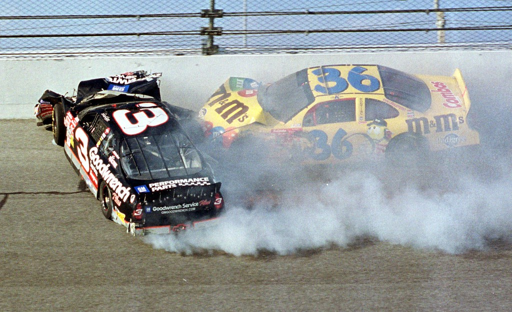 . Dale Earnhardt (3) hits the wall while he getting hit by Ken Schrader (36) during the Daytona 500 Sunday afternoon, Feb. 18, 2001 in Daytona Beach, Fla.    Earnhardt had to be cut from his battered car and was taken to Halifax Medical Center, where he was pronounced dead of head injuries. (AP Photo/Bob Sweeten)