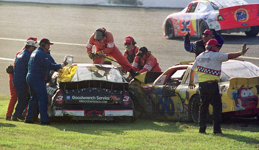 . Workers try to remove Dale Earnhardt (3) from his vehicle after a crash also involving Ken Schrader (36) during the Daytona 500 in this Feb. 18, 2001photo at the Daytona International Speedway in Daytona Beach, Fla. Earnhart was killed in the crash. (AP Photo/Greg Suvino)