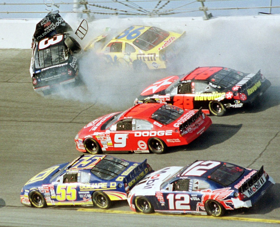 . Dale Earnhardt\'s (3) window pops out of the car after being hit by Ken Schrader (36) during the Daytona 500 Sunday afternoon, Feb. 18, 2001, at the Daytona International Speedway in Daytona Beach, Fla.  Getting by are drivers Bobby Hamilton (55), Jeremy Mayfield (12), Bill Elliott (9) and Ricky Rudd (28). Earnhardt had to be cut from his battered car and was taken to Halifax Medical Center, where he was pronounced dead of head injuries. (AP Photo/Greg Suvino)