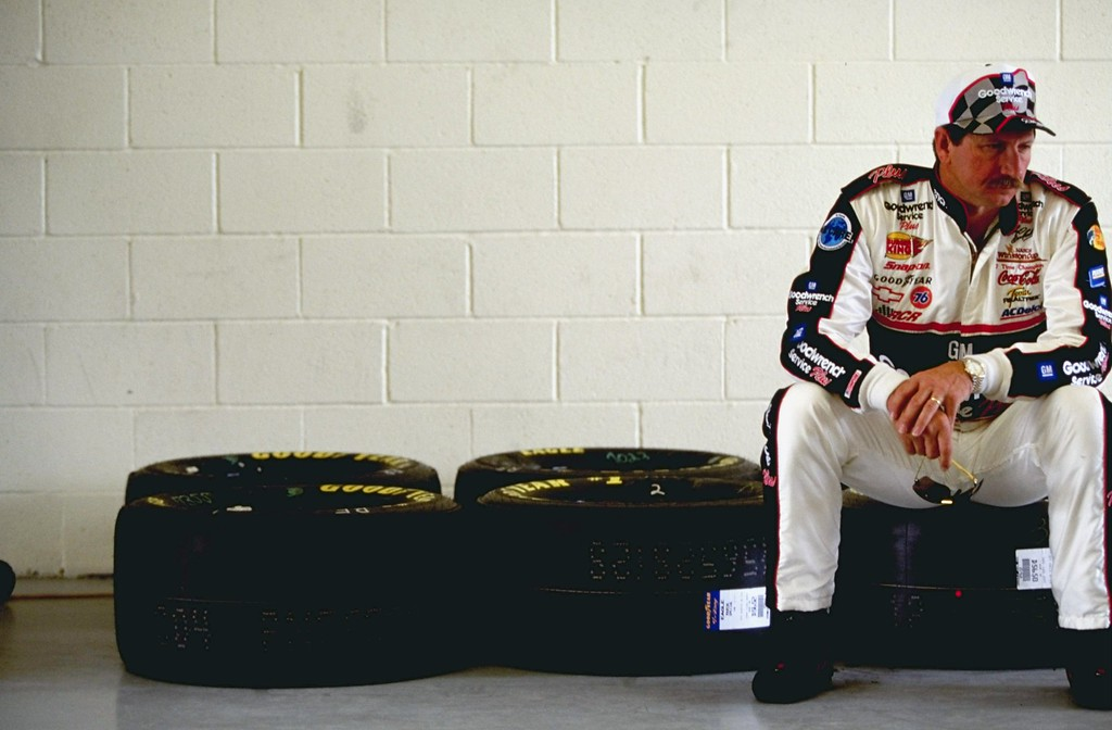 . 5 Mar 1999 file photo:  Dale Earnhardt #3 sitting on some tires looking on during practice for the Las Vegas 400 of the NASCAR Winston Cup Series at the Las Vegas Motor Speedway in Las Vegas, Nevada. (David Taylor/Allsport)