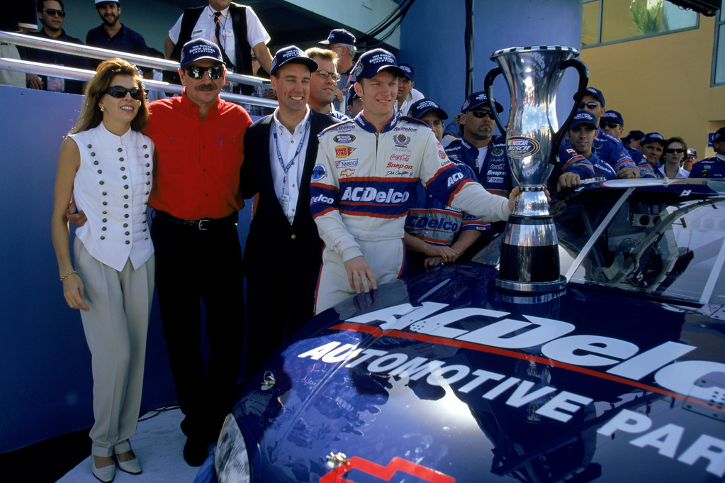 . File - Dale Earnhardt Sr. (center left), owner of the Busch car, poses with driver Dale Earnhardt Jr. (far right) and Teresa Earnhardt after the win in the Hotwheels.com 300 at the Homestead Miami Speedway on November 13, 1999 in Homestead, Florida.  (Photo by Jonathan Ferrey/Getty Images)