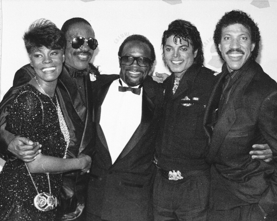 . Grammy winners Dionne Warwick, Stevie Wonder, Quincy Jones, Michael Jackson and Lionel Richie pose together backstage at the Grammy Awards show in Los Angeles, on February 26, 1986.  (AP Photo)