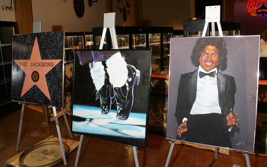 ". (L-R) A replica of the Jackson family\'s ""Walk of Fame\"" star, an original piece of artwork of Michael Jackson from 1983 and a rendering of Jackson as pictured on his 1979 album \""Off the Wall,\"" were on display at The Joint inside the Hard Rock Hotel & Casino May 27, 2007 in Las Vegas, Nevada.   (Photo by Ethan Miller/Getty Images)"
