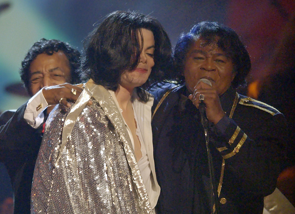 . James Brown, right, embraces Michael Jackson after they perfromed together during the 3rd annual BET Awards Tuesday, June 24, 2003, in Los Angeles. (AP Photo/Kevork Djansezian)