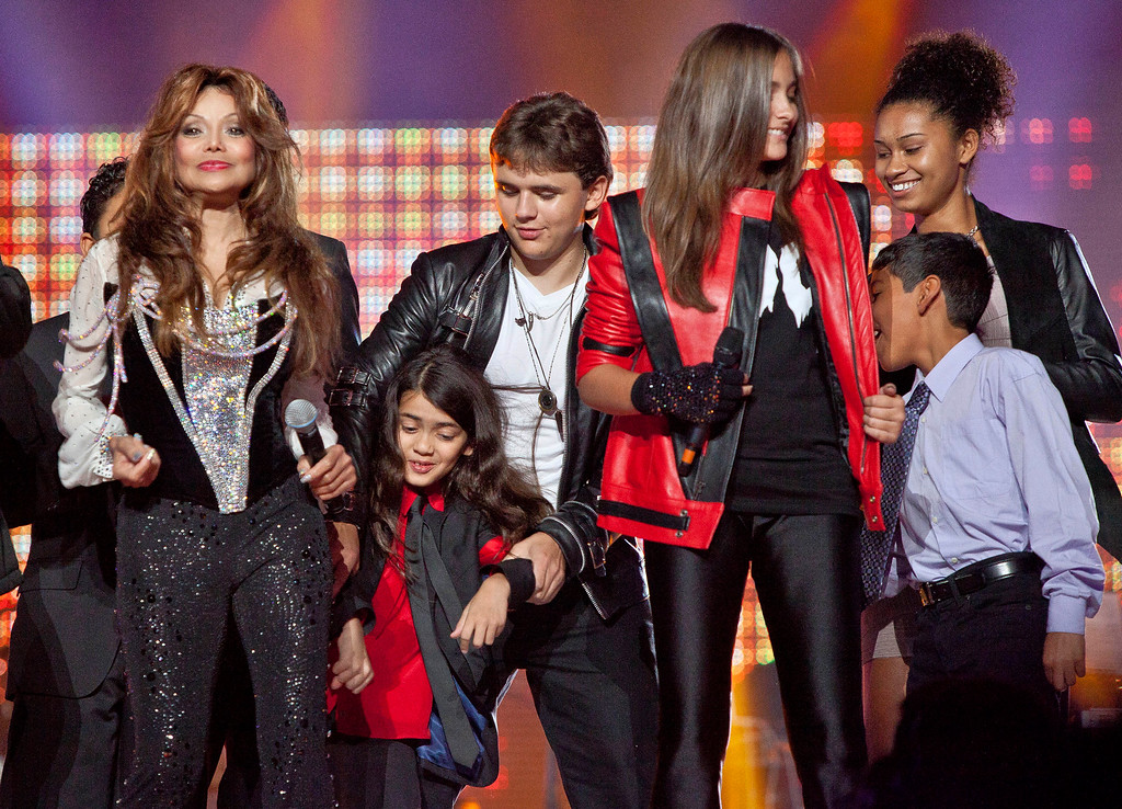 . From left, Latoya Jackson, Prince Michael II \'Blanket\' Jackson, Prince Michael Jackson, Paris Jackson and others join together on stage for the finale of the Michael Forever the Tribute Concert, at the Millennium Stadium in Cardiff, Wales, Saturday, Oct. 8, 2011. (AP Photo/Joel Ryan)