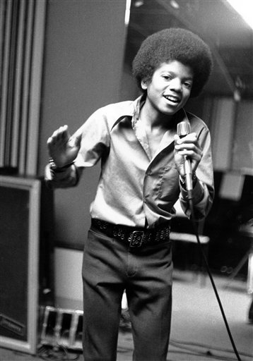 . In this 1972 file photo, singer Michael Jackson at age 13, the youngest member of the singing group Jackson Five, sings in his home in Encino, Ca. (AP Photo, file)