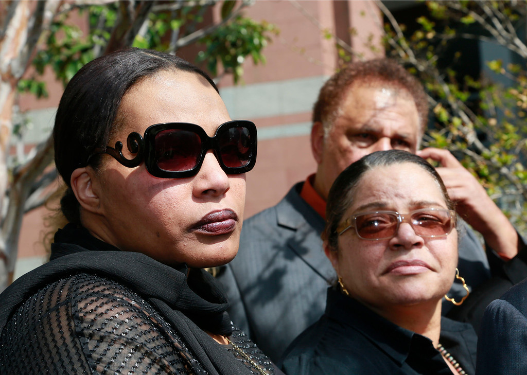 ". FILE - In this Tuesday, March 10, 2015 file photo, Marvin Gaye\'s daughter, Nona Gaye, left, and his ex-wife, Jan Gaye, take questions from the media outside Los Angeles U.S. District Court, after a jury awarded the singer\'s children nearly $7.4 million after determining singers Robin Thicke and Pharrell Williams copied their father\'s music to create ""Blurred Lines.\"" Marvin Gaye�s family is seeking to stop the distribution of �Blurred Lines.� Gaye�s children filed a motion in court Tuesday, March 17, 2015, to prevent the copying, distributing and performing of the hit song featuring Pharrell, Robin Thicke and T.I.  (AP Photo/Nick Ut, File)"