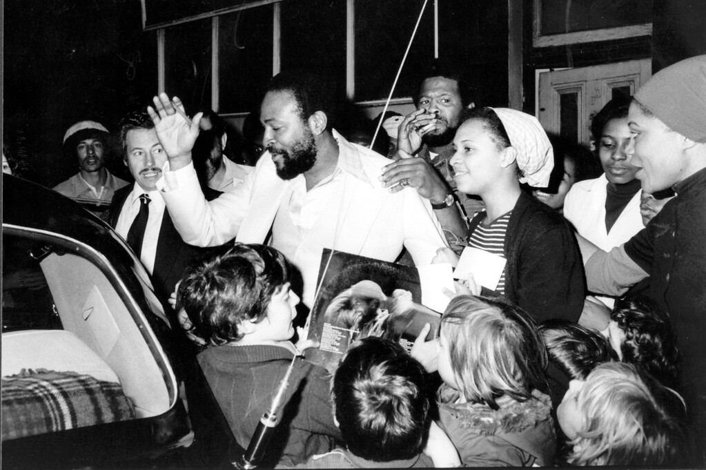 . File - American soul singer Marvin Gaye visits the Mangrove Cafe in All Saint\'s Road, London, and is mobbed by admirers on the way out to his car on October 1, 1976.  (Photo by John Minihan/Evening Standard/Getty Images)