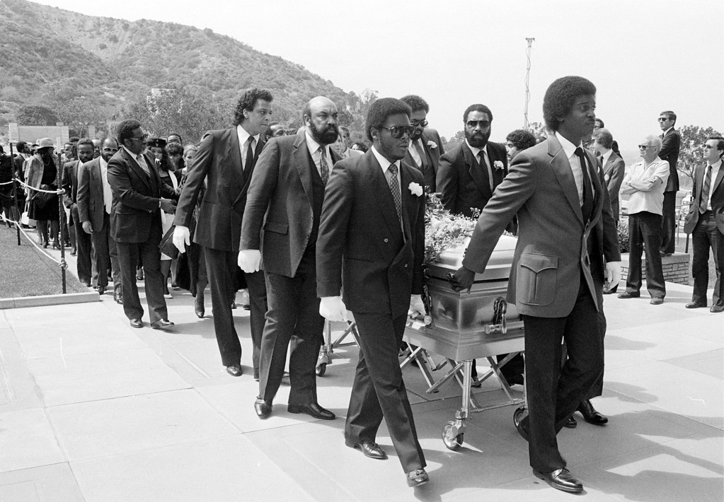 . Friends of the late singer Marvin Gaye Jr. bring the casket into the funeral service home at Forrest Lawn Memorial Park, in Los Angeles, Calif., on April 5, 1984. (AP Photo/Heung Shing Liu)