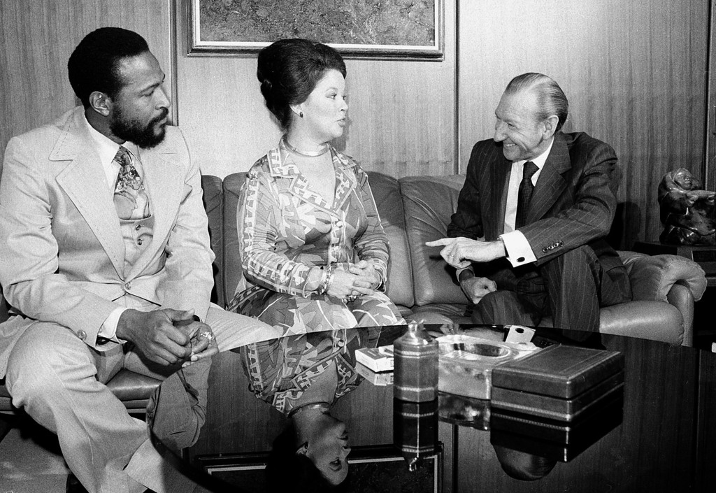 ". Singer-songwriter Marvin Gaye, left, is shown with United Nations Secretary-General Kurt Waldheim, right, and Shirley Temple Black, U.S. Ambassador to Ghana, at the United Nations in New York City, Monday, Oct. 13, 1975.  Gaye was donating proceeds from his Sunday performance ""Salute to the U.N.\"" to UNESCO for an African literacy campaign.  (AP Photo)"