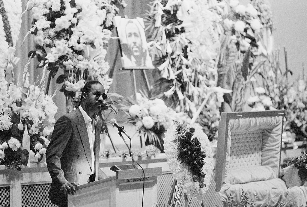 . Singer Stevie Wonder speaks with friends and relatives of Marvin Gaye Jr. during funeral services for the late singer on April 6, 1984 at Forest Lawn Memorial Park in Los Angeles. Gaye was slain in Los Angeles Sunday, the eve of his 45th birthday. (AP Photo/Heung Shing Jiu)