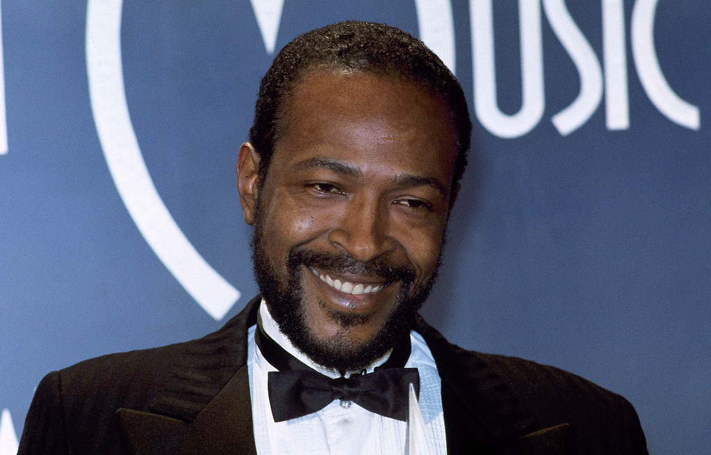 ". File - Singer-songwriter Marvin Gaye is winner of Favorite Soul/R&B Single, ""Sexual Healing,\"" at the American Music Awards in Los Angeles, Calif., Jan. 17, 1983.  (AP Photo/Doug Pizac)"