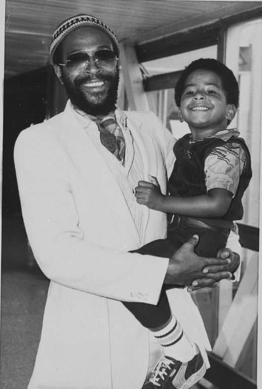. Soul singer Marvin Gaye is seen with his four-year-old son Frankie after arriving in London for a tour of Europe, June 1980.  (AP Photo/Press Association)