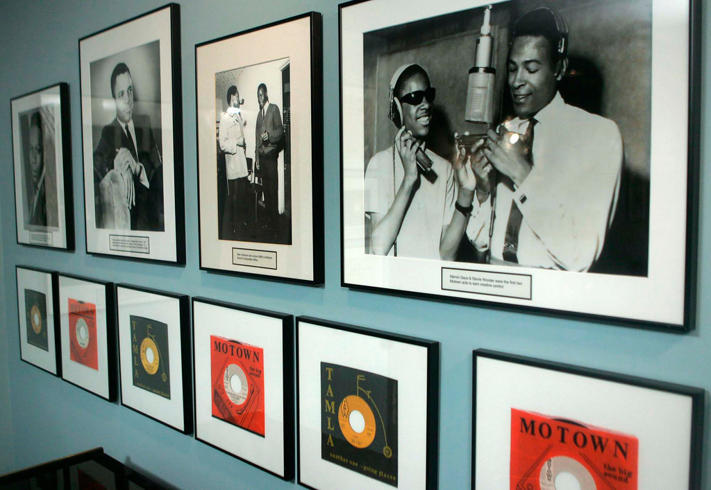 . FILE - In this Jan. 20, 2006 photo, 45\'s and photographs, including Marvin Gaye and Stevie Wonder in photo at right, are displayed at the Motown Museum gallery in Detroit. (AP Photo/Paul Sancya)