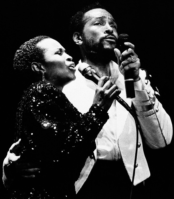 . Marvin Gaye, right, with back up singer Paulette McWilliams at Radio City Music Hall, Tuesday, May 18, 1983, New York.  (AP Photo/Nancy Kaye)