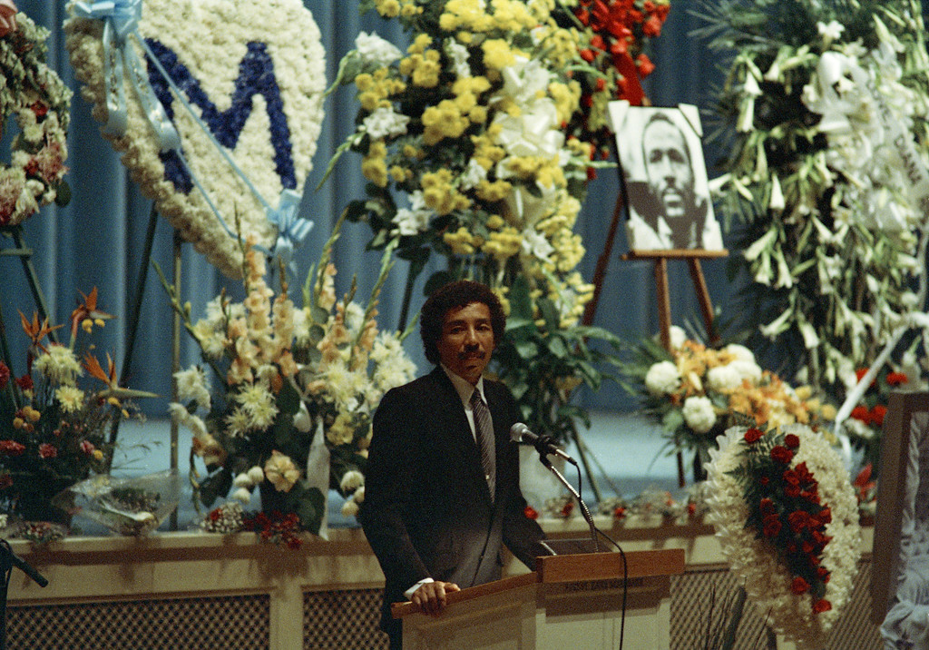 . Singer Smokey Robinson shares his memories of Marvin Gaye Jr. during funeral services for the late singer in Los Angeles, Calif., April 5, 1984. Gaye was slain by his father, Marvin Gay Sr., in his Los Angeles home, April 1, the eve of his 45th birthday. (AP Photo/Liu Heung Shing)