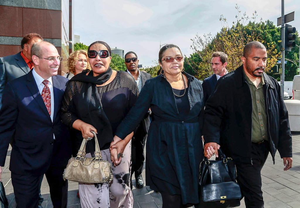 ". Attorney Mark Levinsohn, far left, walks with the late singer, Marvin Gaye\'s family members, from left, daughter, Nona Gaye, ex-wife, Jan Gaye, and son, Frankie Gaye, outside the Los Angeles U.S. District Court after a jury awarded his children nearly $7.4 million after determining singers Robin Thicke and Pharrell Williams copied their father\'s music to create ""Blurred Lines,\"" Tuesday, March 10, 2015. Gaye died in April 1984, leaving his children the copyrights to his music. (AP Photo/Nick Ut)"