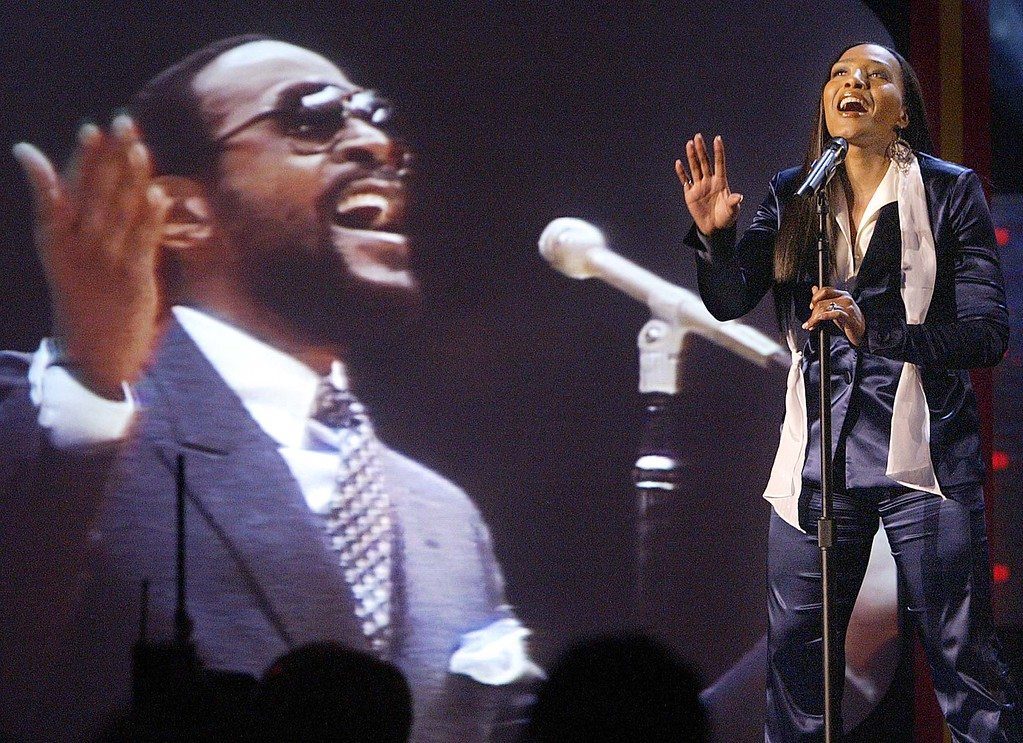 . Actress Nona Gaye, daughter of singer Marvin Gaye, sings the National Anthem, during the 2004 NBA All-Star at Staples Center, Saturday, Feb. 14, 2004, in Los Angeles. (AP Photo/ Kevork Djansezian)