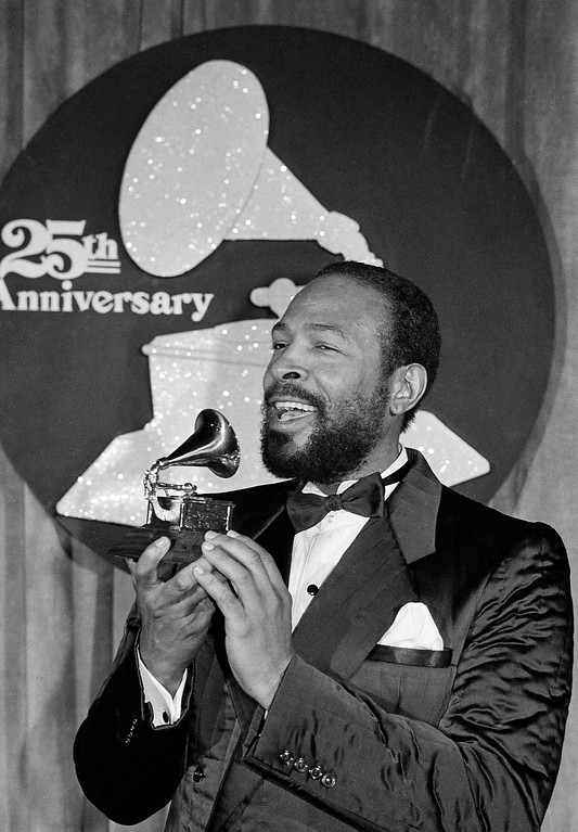 . Marvin Gaye kisses his Grammy Award after he was named top Rhythm & Blues Male Vocalist at the 25th annual Grammy Awards presentation, Wednesday, Feb. 24, 1983, Los Angeles, Calif. Gaye received two Grammys for Best R & B Instrumental Performance and R & B Male Vocalist for his hit song Sexual Healing. (AP Photo)