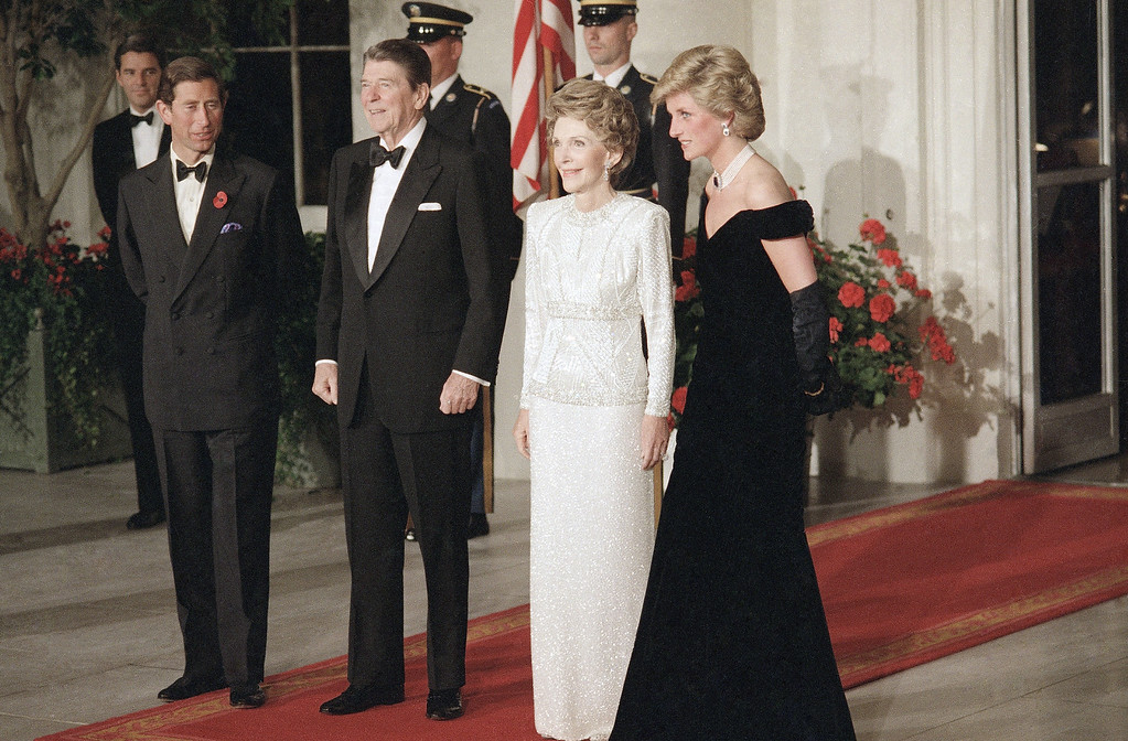 . President  Ronald Reagan and Mrs. Nancy Reagan pose with the Prince and Princess of Wales prior to a private dinner and party at the White House in Washington on Saturday, Nov. 9, 1985. (AP Photo/Scott Stewart)