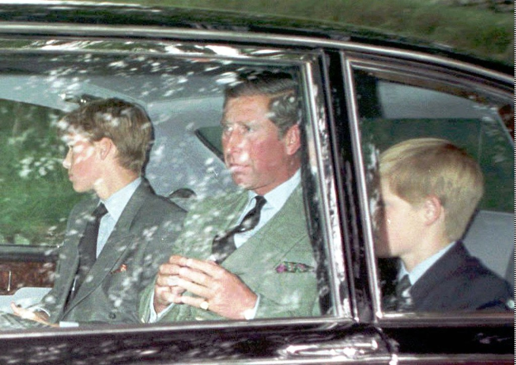 . Britain\'s Prince Charles and his two sons, Prince William, left, and Prince Harry are driven from church in Balmoral, Scotland, Sunday Aug. 31, 1997, after hearing the news of the death of Diana, Princess of Wales. The Princess was killed in a car crash in Paris earlier today along with her friend Dodi Fayed and the driver of the car. (AP Photo)