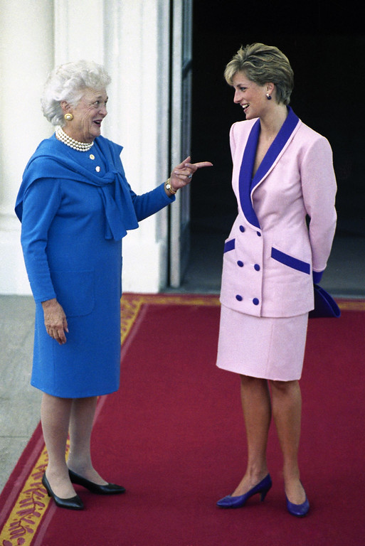. Diana, Princess of Wales, is greeted by first lady Barbara Bush upon arrival at the North Portico of the White House in Washington, Oct. 5, 1990. Mrs. Bush hosted coffee for Diana. (AP Photo/Bob Daugherty)