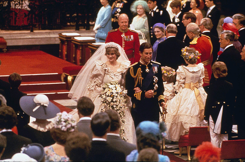 . Prince Charles and his bride Diana, Princess of Wales, march down the aisle of St. Paul\'s Cathedral at the end of their wedding ceremony on July 29, 1981 in London. (AP Photo)