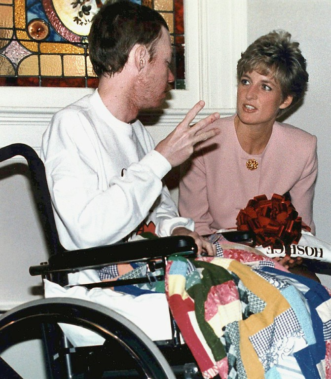 . File - Diana, Princess of Wales, talks with AIDS patient Wayne Taylor at the Casey House AIDS hospice in Toronto Oct. 26, 1991.  (AP Photo/Hans Deryk)