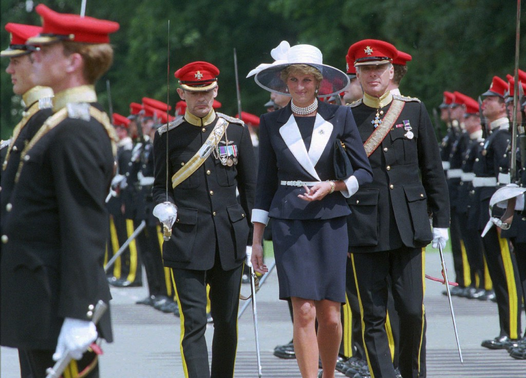 . The Princess of Wales, center, inspects the guards before presenting the new colours to the Light Dragoons, the regiment of which she is Colonel-in-Chief,in Bergen, northern Germany, on Saturday, July 22, 1995. (AP Photo/Christof Stache)