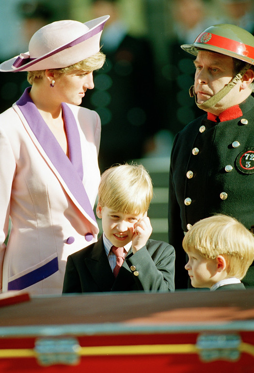 . Princess Diana and her two sons, Prince William, center, and Prince Harry, are seen outside London\'s St. Paul\'s Cathedral where they paid tribute to firefighters who saved London during the World War II blitz, Oct. 25, 1990. (AP Photo/Dave Caulkin)