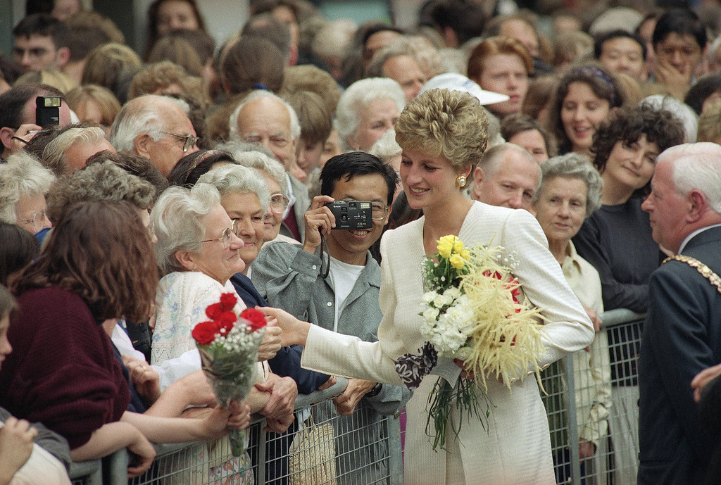 . Diana, the Princess of Wales, shakes hands with well-wishers during a walk about in Cambridge�s Market Square on Thursday, June 17, 1993. The Princess was in the famous English University town for several official functions.  (AP Photo/Findlay Kember)