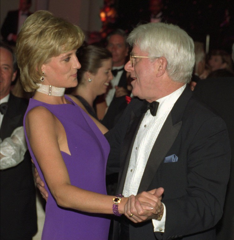 . Princess Diana dances with Phil Donahue on Wednesday night, June 5, 1996, following a Gala Dinner at the Field Museum of Natural History in Chicago. Diana was on a three-day visit to the Chicago area. (AP Photo/John Bartley, Pool)