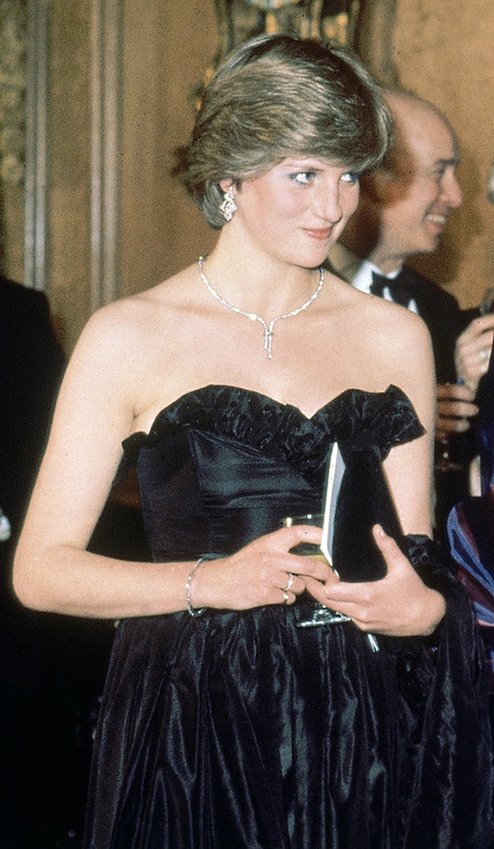 . FILE - In this March 9, 1981 file photo, Lady Diana Spencer, then-fiancee of Britain\'s Prince Charles attends her first official engagement, a charity event at the Goldsmith\'s Hall, in London.  (AP Photo/Peter Skingley, pool, file)