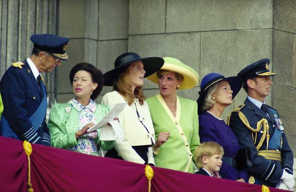 . Prince Harry celebrating his 6th birthday with his mother, Princess Diana, the Duchess of York, left, and the Duke and Duchess of Kent., points to a flyover of Buckingham Palace in London on Saturday, Sept. 15, 1990 by 168 military aircraft in honor of the 50th anniversary of the Battle of Britain. The fly past was the biggest ever since the coronation. (AP Photo/Gill Allen)