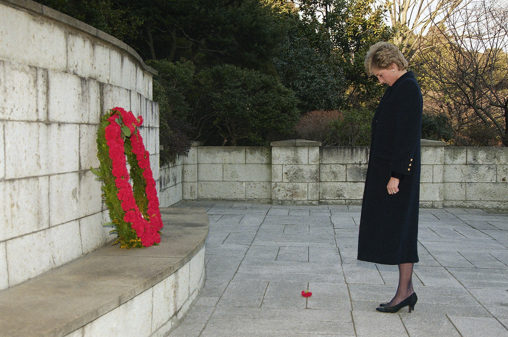 . A flower bud dropped from a wreath laid by Princess Diana, the Princess of Wales lies on the ground as she pays her respects in front of the Cenotaph at the Commonwealth War Graves Cemetery in Yokohama, southwest of Tokyo on Tuesday, Feb. 7, 1995.  (AP Photo/Koji Sasahara)