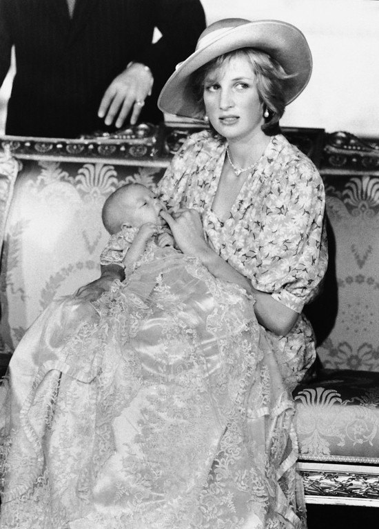 . Princess Diana holds little Prince Williams in the White Drawing Room of Buckingham Palace in London on August 4, 1982 after his christening at the palace in morning on Wednesday. (AP Photo/Pool)