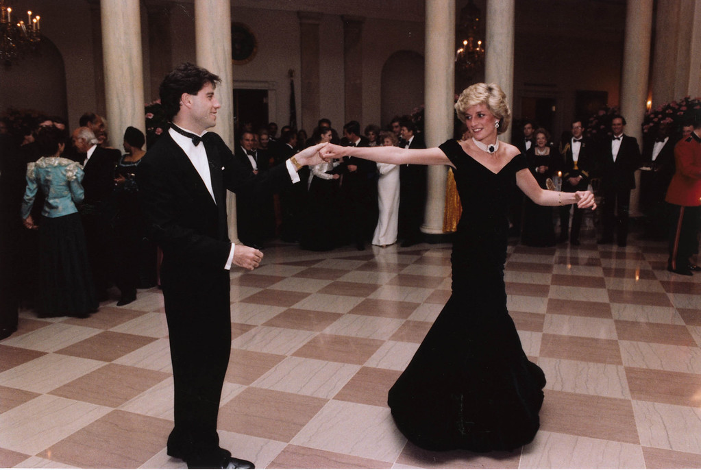 . FILE - In this Nov. 9, 1985 photo provided by the Ronald Reagan Library, actor John Travolta dances with Princess Diana at a White House dinner in Washington.  (AP Photo/Ronald Reagan Library, File)